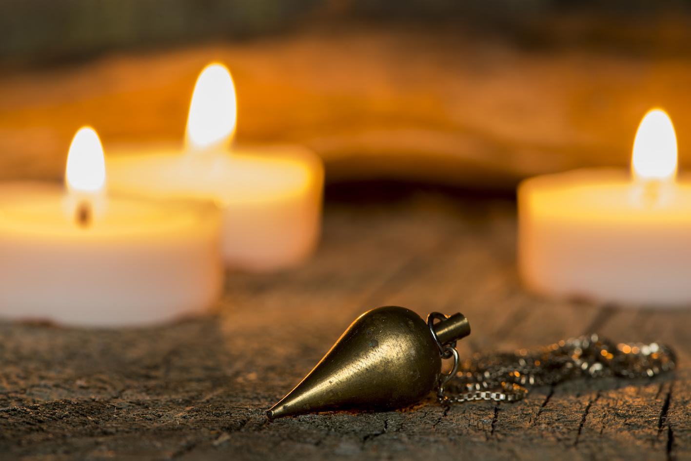 pendolo divinatorio candele